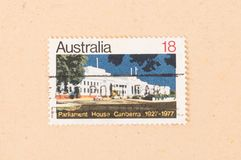 A stamp printed in Australia shows Parliament House Canberra, circa 1977. AUSTRALIA - CIRCA 1977: A stamp printed in Australia shows Parliament House Canberra royalty free stock photo