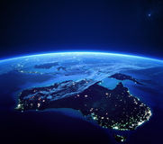 Australia with city lights from space at night Stock Images