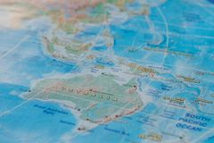 Australia in close up on the map. Focus on the name of country. Vignetting effect.  royalty free stock photos