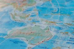 Australia in close up on the map. Focus on the name of country. Vignetting effect.  royalty free stock photo