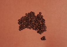 Australia continent map made of coffee beans. On brown background Royalty Free Stock Image