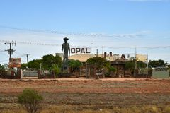 Australia, Coober Pedy, Opal Shop. Coober Pedy, SA, Australia - November 14, 2017: Miner sculpture and shop for opal and jewelry in the outback village in South stock images