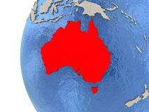 Australia on 3D globe. Map of Australia on globe with watery blue oceans and landmass with visible country borders. 3D illustration stock illustration