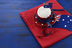 Australia Day, January 26, theme table setting with red, white and blue cupcake. Happy Australia Day, January 26, theme table setting with red, white and blue Royalty Free Stock Image