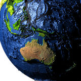 Australia on Earth with exaggerated mountains. Australia on model of Earth with exaggerated surface features including ocean floor. 3D illustration. Elements of Stock Photo