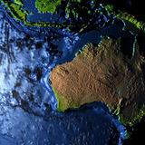 Australia on Earth with exaggerated mountains. Australia on model of Earth with exaggerated surface features including ocean floor. 3D illustration. Elements of Stock Images
