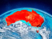 Australia on Earth. Orbit view of Australia highlighted in red on planet Earth with highly detailed surface textures. 3D illustration. Elements of this image Royalty Free Stock Photos