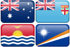 Australia, Fiji, Kiribati, Marshall Islands. Australian, Fiji, Kiribati, and Marshall Islands flag rectangular buttons.  Part of set of country flags all in 2:3 Royalty Free Stock Photos