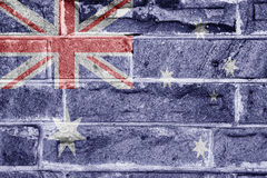 Australia flag. Flag of Australia on textured sandstone brick wall background Royalty Free Stock Photo