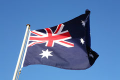 Australia Flag, Australian. The Australian flag fluttering in the wind. Focus on near end of flag. Some motion blur on end of flag Stock Photo