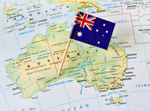 Australia map flag pin. Australia paper flag pin on a map showing countries, states grid (series image royalty free stock images