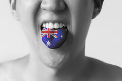 Australia flag painted in tongue of a man - indicating English language and Australian accent speaking Royalty Free Stock Photo