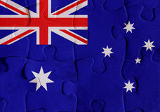 Australia flag puzzle. Illustration of a flag of Australia over some puzzle pieces. Its a JPG image Stock Photography
