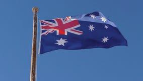 Flag Australia. Australia flag in slow motion on blue sky stock footage