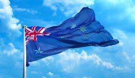 Australia flag waving in blue cloudy sky Stock Photos