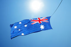 Australia flag waving in blue cloudy sky Stock Photography