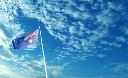 Australia flag waving in blue cloudy sky Stock Images