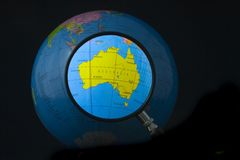 Australia in focus. Magnifying glass focusing on Australia Stock Photos