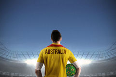 Australia football player holding ball Royalty Free Stock Photos