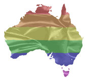 Australia Gay Pride Flag. The mult coloured gay pride silk flag with Australia map silhouette Royalty Free Stock Photography