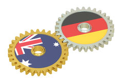 Australia and Germany flags on a gears, 3D rendering Royalty Free Stock Photos