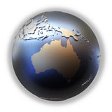 Australia on golden metallic Earth. Australia on elegant metallic model of planet Earth with blue ocean and shiny embossed continents with visible country Stock Photo
