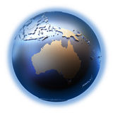 Australia on golden metallic Earth. Australia on elegant metallic model of planet Earth with blue ocean and shiny embossed continents with visible country Royalty Free Stock Photography