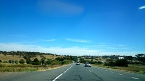 Australia Highway. A beautiful Australia highway with the view of cars, farms and town stock photo