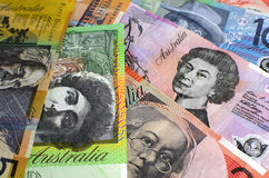 Australia hundred, fifty, twenty, ten and five dollar notes. Australian paper money, including one hundred, twenty, ten, five and fifty dollar notes against a Stock Photography