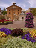 Australia: Hyde Park Barracks Sydney. Hyde Park Barracks convict museum Sydney, a World Heritage listed site with urban flower planters Royalty Free Stock Photography
