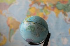 Australia map on a globe. With the whole world as background royalty free stock photo