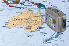 Australia map and travel case with stickers (my photos). Australia map and case with stickers (my photos) - travel background Stock Images