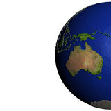 Australia on model of Earth with embossed land Royalty Free Stock Photo