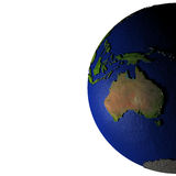 Australia on model of Earth with embossed land Royalty Free Stock Image
