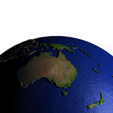 Australia on model of Earth with embossed land Stock Images