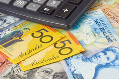Australia New Zealand currency. Australia and New Zealand currency pair commonly used in forex trading with calculator Stock Photo