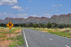 Australia, NT, Larapinta Drive along McDonnell Range. Australia, NT, warning sign for bus stop on Larapinta drive along McDonnell range stock photography