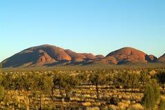 Australia, NT, Kata Tjuta,. Australia - rock formation Kata Tjuta - aka the Olgas - a mystical palce for Aborigines and steppe with spinifex grass and desert stock photos