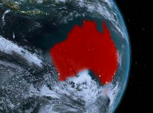Night over Australia on Earth. Australia from orbit of planet Earth with clouds at night with highly detailed surface textures. 3D illustration. Elements of this Stock Photography