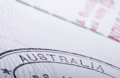 Australia passport stamp. Detail of an Australian passport immigration stamp showing the word Australia Royalty Free Stock Images