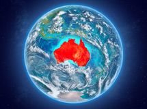 Australia on planet Earth in space. Australia in red on model of planet Earth with clouds and atmosphere in space. 3D illustration. Elements of this image Stock Photos