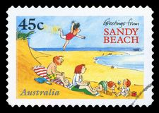 AUSTRALIA - Postage stamp. AUSTRALIA - CIRCA 1996: A stamp printed in Australia shows greetings from sandy beach, circa 1996 stock photography