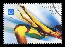 AUSTRALIA - Postage Stamp. AUSTRALIA - CIRCA 2004: A used postage stamp from Australia, symbolizing the Swimming event at the Athens 2004 Summer Olympic Games royalty free stock images