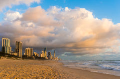 Australia, Queensland, Surfers Paradise beach and city at sunris Stock Images