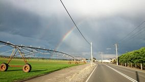 Australia Road View - Irrigator and Double Rainbows Royalty Free Stock Photos