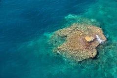 Australia Rock. Australia shaped coral rock in water Royalty Free Stock Photos