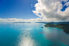 Australia's Whitsunday Islands. Dramatic Helicopter view of the Whitsunday Islands and surrounding seas in Queensland, Australia Royalty Free Stock Images