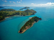 Australia's Whitsunday Islands. Dramatic Helicopter view of the Whitsunday Islands and surrounding seas in Queensland, Australia Stock Image