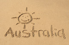 Australia in the Sand. A picture of sun and the word Australia drawn in the sand Royalty Free Stock Photos