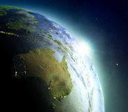 Australia from space during sunrise. Sunrise above Australia. Concept of new beginning, hope, light. 3D illustration with detailed planet surface, atmosphere and Stock Images